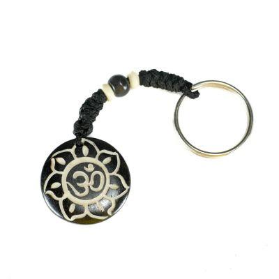 Schlüsselanhänger Om di bunga teratai hitam