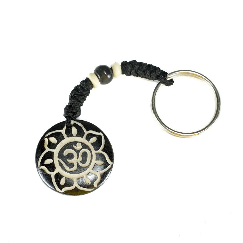 Knochenschlüsselanhänger Om di bunga teratai hitam