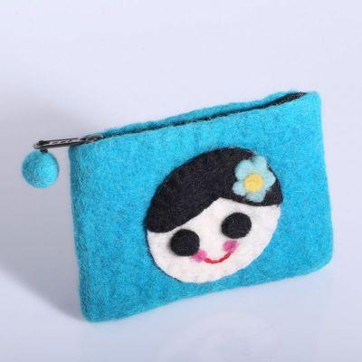 Kleine Geldbörse mit einem Mädchenmotiv Türkis